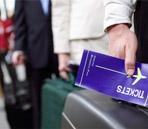 Airplane-Passenger-Holding-Ticket
